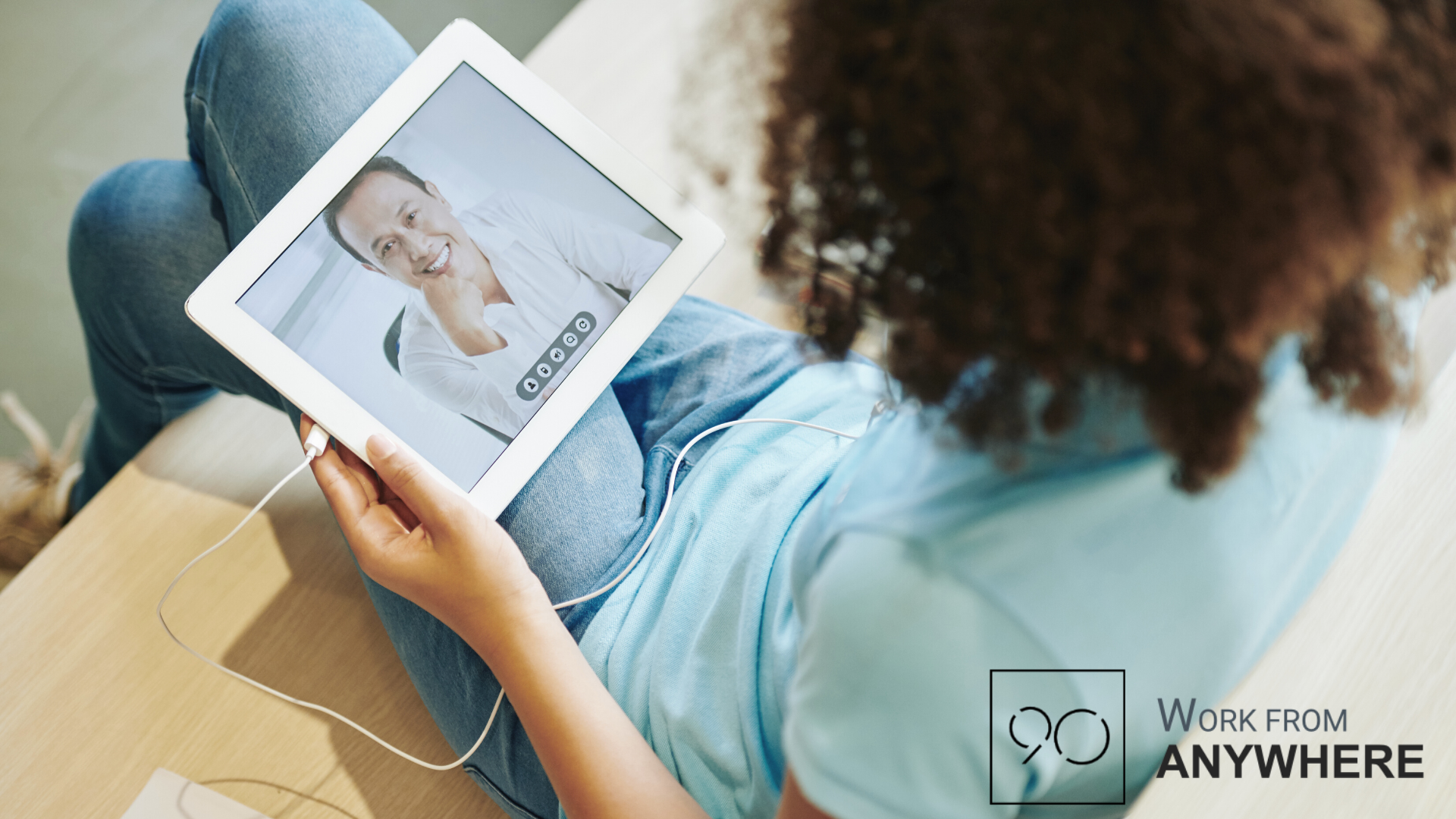 Woman on a tablet video call